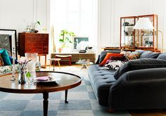 Gorgeous, sophisticated space.  Love the round coffee table and the deep seated sofa.