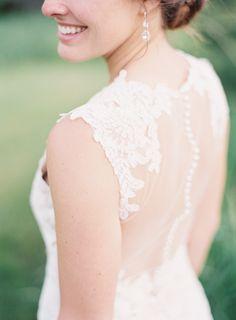 Elegant lace and sheer wedding dress: Photography : Natashia Nicole Photography Read More on SMP: http://www.stylemepretty.com/wisconsin-weddings/2016/08/24/rustic-northwoods-wedding/