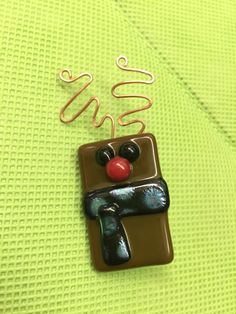 A personal favorite from my Etsy shop https://www.etsy.com/listing/259635994/mini-fused-glass-reindeer-pin