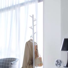 This slim coat rack holds a surprising amount of items while taking up very little space. It has eight adjustable branches that can be rotated for different hanging configurations.