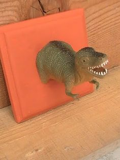 Dinosaur Hooks for kids rooms DIY -- this is such a totally awesome idea! I know it's not superheroes...maybe a bathroom? Cute!