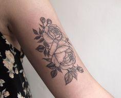 Floral linework on bicep Tattoo People Toronto Jess Chen