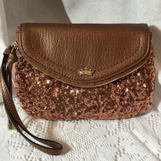 Fantastic Juicy Couture Sequined Handbag Wristlet! Fantastic Juicy Couture Sequined Handbag Wristlet! Copper  color with Black lining. Length 8.5, Width 6.5.  Brand New!! Juicy Couture Bags Clutches & Wristlets
