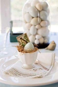 Easter brunch table setting. Love the Easter grass under the egg!