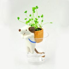 Let your plants water themselves! Choose these self watering planters from a monkey, dog or cat planters.