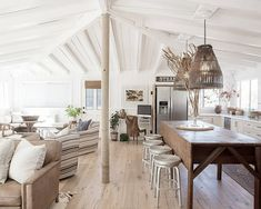 Lots of relaxation 'zones' in this gorgeous open plan living area