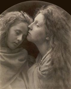 The Kiss of Peace - 1869, by Julia Margaret Cameron, a talented early woman photographer.
