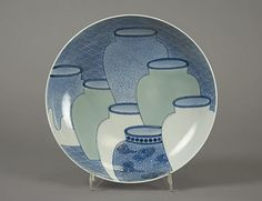 Dish with Design of Seven Jars Period: Edo period (1615–1868) Date: 1700–1720s Culture: Japan Medium: Porcelain with celadon glaze and underglaze blue (Hizen ware, Nabeshima type) Dimensions: H. 2 1/2 in. (6.4 cm); Diam. 8 in. (20.3 cm) Classification: Ceramic