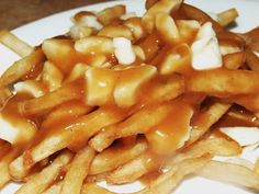 Poutine recipe - a Quebec dish, made with french fries, topped with brown gravy and cheese curds.  So good!