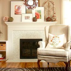A cozy white fireplace surround features our Brio glass mosaic blend White Linen. www.modwalls.com