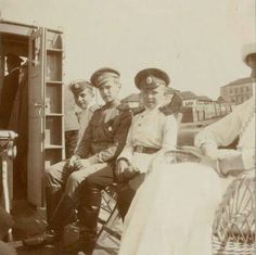 Tsarevich Alexei Nikolaevich Romanov of Russia with playmates,Vasya Agayev and Zhenya Makarov,who were cadets from a military school.This photo was taken by the Dnieper River in 1915.A♥W