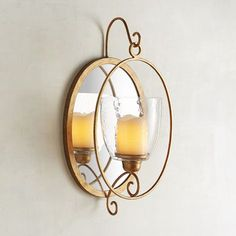 Watch how the glow of candlelight intensifies the beauty of our handcrafted iron and mirror sconce. And while you're at it, take a peek at how amazing you look reflected in its golden mood lighting. Modern Candle Holders, Wall Candle Holders, Candle Stand, Mirror Candle Wall Sconce, Oval Mirror, Candles, Dining Room, Glow, Watch
