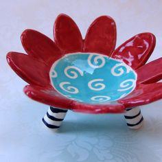 Funky ceramic dish with striped legs - it's a soap dish, a candle holder, a jewelry dish, a place for the car keys, spare change, by the kitchen sink, on your dresser, in the bathroom . . .$25