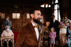 Groom in Brown Velvet Wedding Jacket and Bow Tie | By Taylor-Hughes Photography | Micro Wedding | Boho Wedding | Registry Office Wedding | Town Hall Wedding | Dried Flowers for Wedding | Flower Crown for Wedding | Dried Flower Crown | Groom Wedding Suit | Groom Dinner Jacket