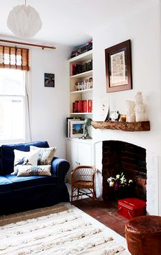 Mantle Makeover: How To Give Your Hearth a New Look // mantle decorating ideas, Moroccan wedding blanket, rustic wood shelf, blue sofa