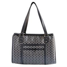 The Payton is a stylish, timeless, classic designer dog carrier. This unisex dog carrier is a popular option dog bag for men or women. This dog carrier is trimmed in Reverse Noir Dots faux leather with silver signature hardware and is roomy enough to accommodate dogs up to 12 lbs.