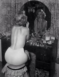 Marilyn applying make-up.