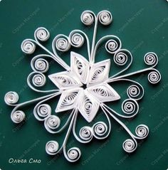 Quilled snowflake. http://www.auntannie.com/DecorativeCrafts/Quilling/