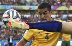 Australia's Tim Cahill, left, watches as Netherlands' Ron Vlaar clears the ball during the group B World Cup soccer match between Australia and the Netherlands at the Estadio Beira-Rio in Porto Alegre, Brazil, Wednesday, June 18, 2014.