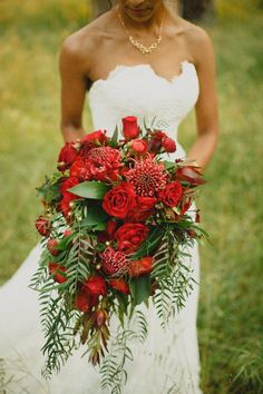 Overgrown and vibrant red tropical bridal bouquet | Image by Samuel Goh Photography
