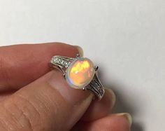 INTENSE colors of the fire AAA+ natural Opal Cabochon silver ring with white topaz micro paved band, vivid rainbow spectrum play of color