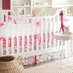Hot pink pattern mixing is super cool in this crib set. #cribbedding #hotpink #patternmix #nursery