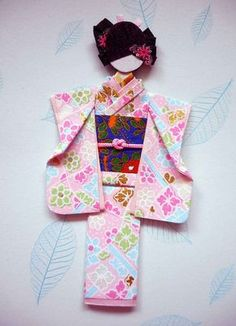 """Hand-folded Japanese paper doll (""""ningyo"""") using Japanese """"yuzen washi"""" for kimono and obi, viscose cord on obi, and nail art stickers and origami paper strip for hair décor. Origami Cards, Origami And Kirigami, Paper Crafts Origami, Diy Paper, Paper Quilling, Paper Art, Oragami, Asian Quilts, Asian Cards"""