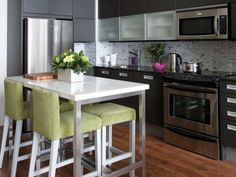 Create an instant breakfast bar like condo owners Erin and Ryan did on HGTV's Pure Design by joining two stainless steel Ikea carts with a custom marble countertop.