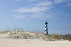 """Old Lighthouse Beach, Hatteras Island - The Best Beaches in North Carolina - Southernliving. This golden stretch of the Cape Hatteras National Seashore offers a heady mix of wind- and water-sports, plus top-notch shelling. Surfers especially prize the big breakers: a reminder of the area's """"Graveyard of the Atlantic"""" maritime history."""