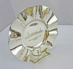 Exquisite Art Deco styling is the main characteristic of this impressive, cigar-size ashtray from Koch & Bergfeld for the North German Lloyd ocean liners. Rare broadside view of the ship Europa. This is truly a special piece. 1929