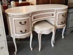 This kidney-shaped desk/vanity has been repurposed with Dixie Belle Paint Company's Fluff mineral paint and Best Dang Brown Wax. Just another perfectly repurposed furniture project from Just Repurposed in Hanceville, AL.