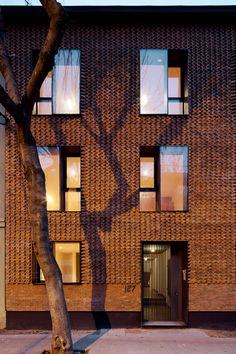 Textured brick facade. Project E_RC by MAPA in Santiago, Chile