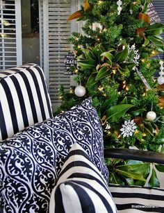if you must use an artificial Christmas tree, adding clusters of little gem magnolia will certainly make it feel more natural  <3