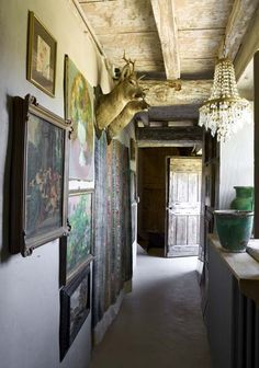 Rustic chateau style hallway art collage display...