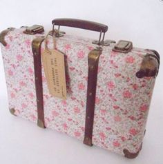 Vintage floral storage suitcase
