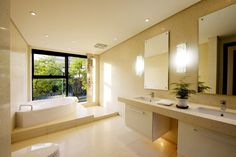 Spacious Bathroom With Corner Soaking Tub And Double Sinks