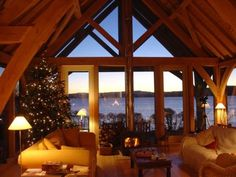Oak frame barn room on a Christmas night overlooking estuary in Devon, by Roderick James Architects Devon House, Oak Framed Extensions, Oak Frame House, Timber Architecture, Houses In France, My Dream Home, Ideal Home, Future House, Building A House