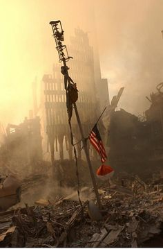US flag flies from a television antenna on September 2001 amid the rubble of the World Trade Center. The antenna was once at the top of one of the 110 story twin towers. World Trade Center, Trade Centre, 11 September 2001, Remembering September 11th, We Will Never Forget, Lest We Forget, Historia Universal, Iconic Photos, Interesting History