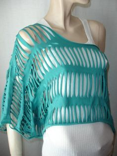 shredded t-shirt. If used a longer shirt or an old dress this would b a great bathing suit cover up!!