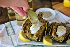 Grilled artichokes are easy and delicious! Fresh artichokes get a bit of char for a fun, summertime appetizer. Get your favorite dip ready! Grilled Artichoke, Artichoke Recipes, Veggie Side Dishes, Side Dish Recipes, Healthy Appetizers, Appetizer Recipes, Vegetarian Recipes, Cooking Recipes, Healthy Recipes