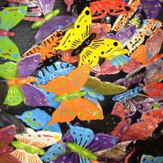 A lot of hand painted ceramic butterflies.