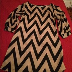 Chevron Short dress Black & Tan short drees line A style fits loose. Measurements from shoulder down 31 inches, bust ( side to side) 17 inches  widest part of hips 18.5 inches Dresses Mini