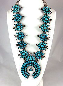 Territorial Indian Arts Brilliant blue natural turquoise sets off the large scale of this old Zuni necklace, a squash blossom with clusters of yummy stones.