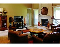 2088 Ravenstone Loop, College Station, TX Stunning living room with floor to ceiling stone fireplace accented by two large windows overlook the backyard.  The kitchen opens to the living area from the eating bar and also features granite counters, pantry, and stainless appliances.  This 3 way split home has a spacious master that features plenty of natural light with a tall tray ceiling. Master bathroom has a jetted tub, double sinks, and a spacious closet.