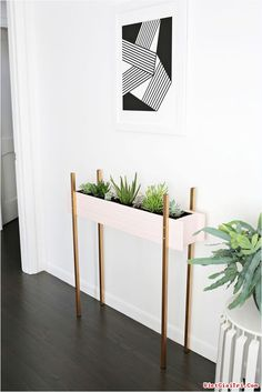 Skinny Planter Stand DIY (A Beautiful Mess) You can call it a coping mechanism, but the colder it gets in winter, the more plants I add to my house. Adding tropical or desert plants into my space totally tricks my brain into thinking warm and h Diy Home Decor, Room Decor, Diy Casa, Diy Plant Stand, Plant Stands, Plant Box, Beautiful Mess, Plant Decor, Diy Furniture