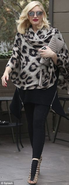 Fashion designer: Gwen covered up in a leopard print shawl and wore a black sweater over black leggings