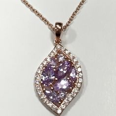 "Rose Gold ""Dream Drop"" Necklace 925 Sterling Dreamy Rose Gold plated 925 Sterling Silver necklace featuring light amethyst color CZ stones    16"" + 2"" extender for 18"" wearable length.  Pendant is 1"" height including bail and 0.5"" across design. xoCouture Jewelry Necklaces"