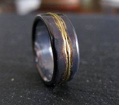 This has Andrew written all over it!!  Hey, I found this really awesome Etsy listing at https://www.etsy.com/listing/386238100/man-wedding-ring-8mm-rustic-man-wedding