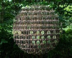 """Hundreds of reflective """"pennies"""" form this spherical sculpture, created by Giles Miller's London design studio for Devon's Broomhill Sculpture Park."""