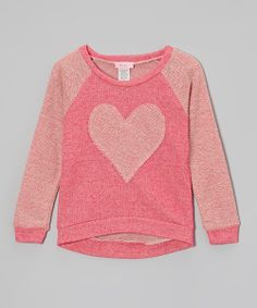 Sporty meets sweet with this lovely piece. Its comfy sweatshirt silhouette is embellished with a darling heart for a charming, easy-to-wear look. 92% cotton/ 8% spandexHand washMade in the USA